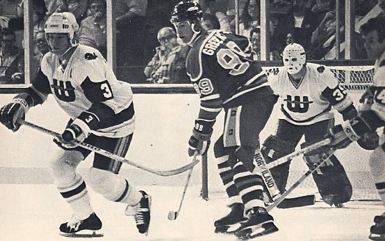 Brad Selwood and Cap Raeder keep an eye on a young Wayne Gretzky