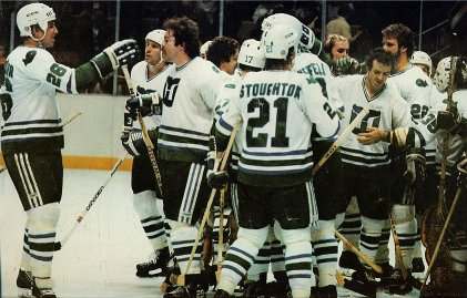 Don Nachbaur, Al Sims, Rick MacLeish, Blaine Stoughont, Dave Keon and the rest of the Whalers celebrate a win