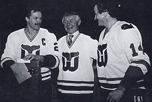 John McKenzie watches his number 19 raised to the roof of the Civic Center with Rick Ley and Dave Keon