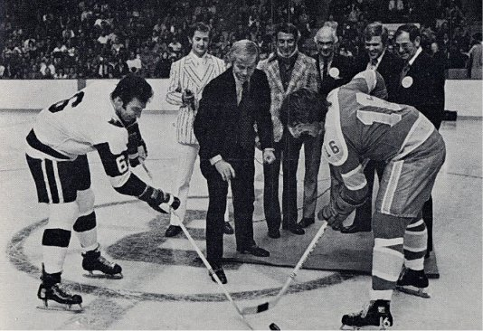 Ted Green takes the ceremonial face-off aginst Derek Sanderson in the Whalers first ever game