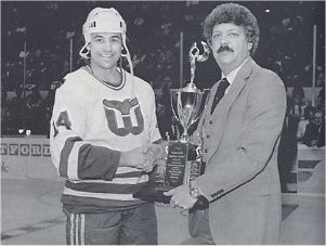Greg Malone accepts the 1984 Frank Keyes Memorial Unsung Hero award