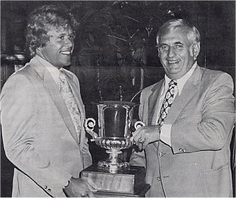 Howard Baldwin receives the 1973-74 WHA Eastern Division Trophy