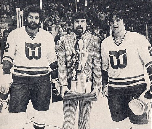 Larry Giroux and Pat Boutette accept the 1980 Frank Keyes Memorial Unsung Hero award